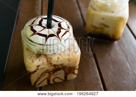 coffee iced coffee mocha on table wood in cafe