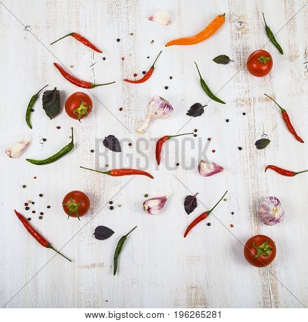 Vegetables And Spices In A Wooden Table.