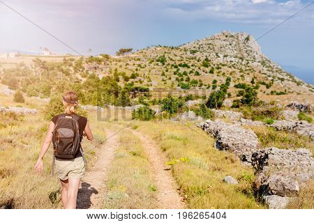 Young Woman With Backpack At Mountain Trail.