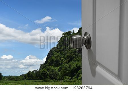 White door open to nature and empty space for text or foreground with clipping path and changing the background