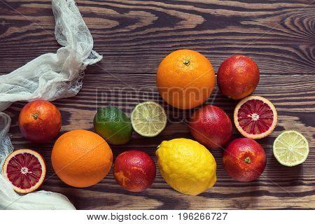 Citrus Fruits Over Old Dark Wooden Background.