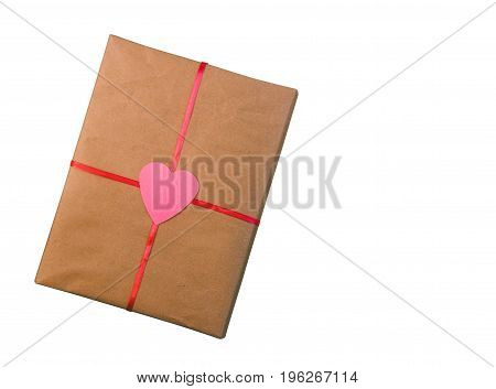 gift for the Valentine's day wrapping paper tied with a red ribbon with a heart isolated on white background with space for text top view close up tinted photo