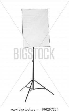 A front picture of a bright black softbox isolated over the white background. Professional studio flashlight on a tripod. Modern photographic technology for a high resolution.