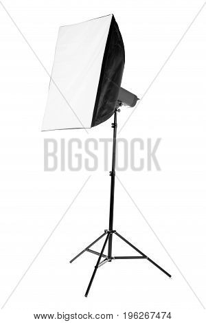 A professional softbox for photo shootings isolated on a white background. A new saturated black softbox on a tall tripod. Photographic business. Equipment for a photo studio.