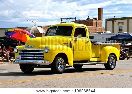 MANDAN, NORTH DAKOTA, July 3, 2017: The 4th of July Rodeo Days 3 day celebration includes the rodeo, Art in the Park, and downtown parade where this refurbished 1949 Chevy pickup is displayed.