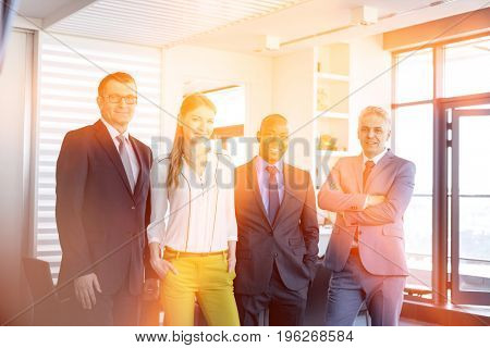 Portrait of confident multi-ethnic business people in office
