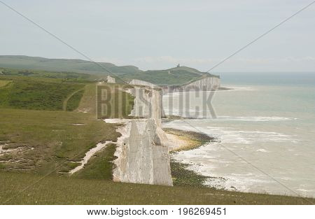 View along the Seven Sisters chalk cliffs from Cuckmere Haven near Eastbourne East Sussex England. Beachy Head in distance.