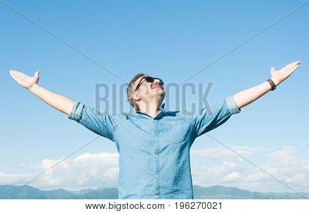 Man Feeling Good And Enjoying Nature
