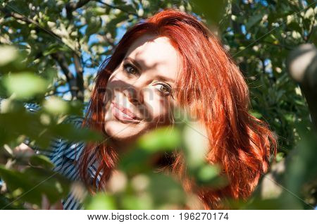 Beautiful Redhead Female Spending Time In The Nature