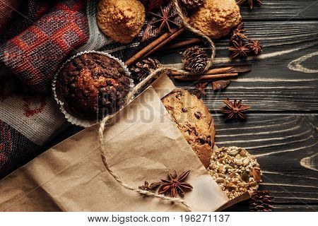 Cookies Cupcakes And Spices On Wooden Background, Stylish Rustic Winter Flat Lay. Space For Text. Co