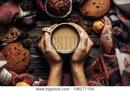 Hands Holding Coffee Cookies And Spices On Wooden Rustic Background. Stylish Winter Flat Lay. Space