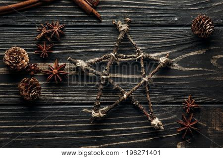 Stylish Rustic Winter Flat Lay Of Star And Anise And Pine Cones On Wooden Background With Space For