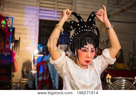 Chinese Opera Member Prepares At Backstage