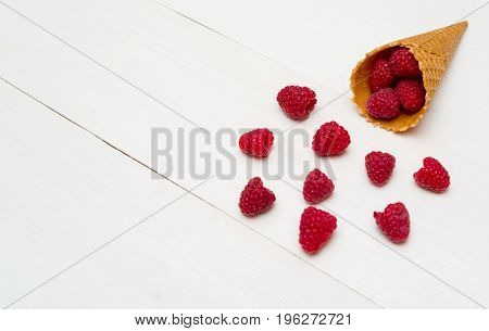 Sweet Fresh Organic Raspberries In Waffle Cone, Free Space. Fresh Berries In Cone On White Wooden Ba