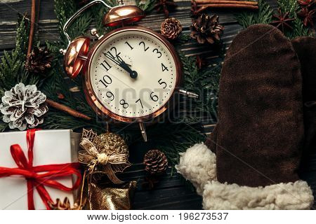 Christmas Stylish Vintage Clock With Almost Twelve Hour And Presents Ornaments And Branches On Rusti