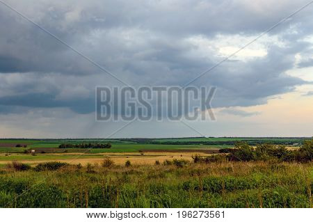 Summer Landscape With Dramatic Sky On Sunset