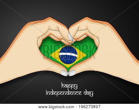 illustration of hands and heart design in Brazil flag background with Happy Independence Day text on the occasion of Brazil Independence Day
