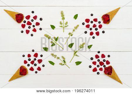 Top View Of Sweet Fresh Organic Raspberries And Blackberries In Waffle Cones And Green Leaves. Fresh