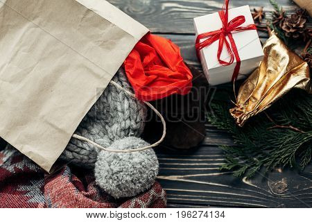 Christmas Shopping Concept. Big Sale. Seasonal Rustic Background With Bags Of Buyed Clothes Presents