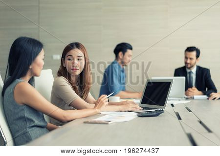 Two Asian Business woman working and meeting in conference room. Business people discussing together in conference room during meeting at office.
