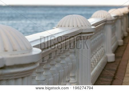 Beautiful White Railing Against The Sea And Sky Background