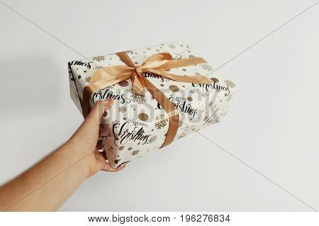 Hand Holding Stylish Christmas Present Isolated. Giving Box. Gift Ideas. Seasonal Greetings Concept.