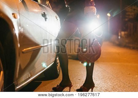 Roadside Prostitute At Night, Color Image, Horizontal Image