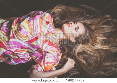 young blonde beauty woman  portrait with beautiful very long hair lie down studio shot eyes closed