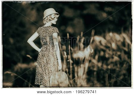 Classic Black And White Photo Of 1930S Summer Fashion Woman With Dress And Straw Hat Standing With H