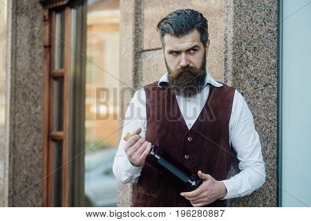 Man Holding Bottle Of Wine