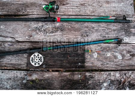 Fishing tackle, rod on a wooden background