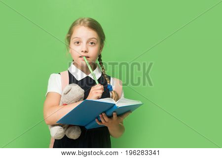 Kid In School Uniform Isolated On Green Background