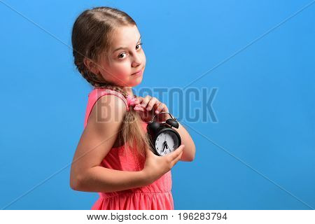 School Girl With Interested Face Isolated On Blue Background