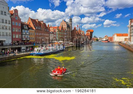 GDANSK, POLAND - JULY 13, 2017: Summer scenery of Motlawa river in Gdansk in summer day, Poland. Gdansk is the historical capital of Polish Pomerania.