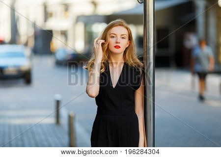 Model In Black Stylish Suit And With Red Lipstick