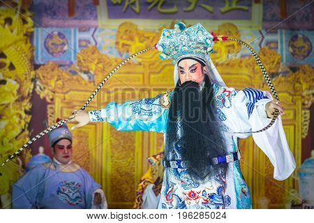 A Member Of Chinese Opera Group Perform On Stage