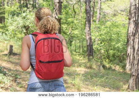 Beautiful young girl with a backpack in the tourism campaign