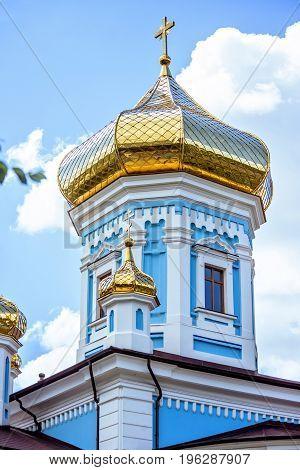 Ciuflea monastery sf teodor tiron, Chisinau, Moldova, sunny day blue sky trees and flowers