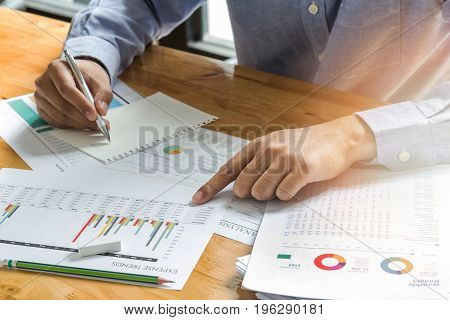 Businessman Take A Note On Documents In Office