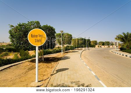 Road round yellow sign with the inscription: The maximum speed is 30 kilometers per hour. Egypt.