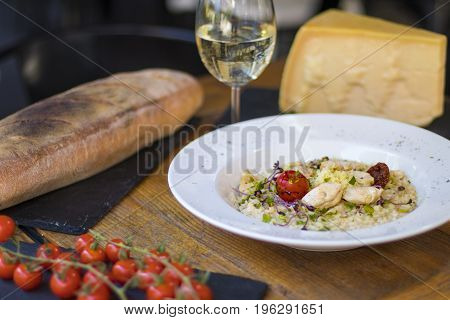 A Plate Of Risotto With Parmesan And Chicken
