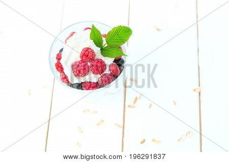 Dessert Layered Pudding With Raspberry And Black Currant In Glass