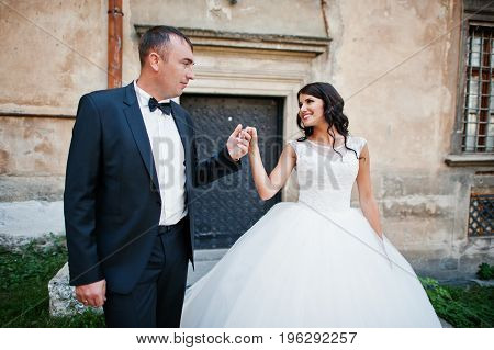 Amazing Young Attractive Newly Married Couple Walking And Posing In The Downtown With Beautiful And