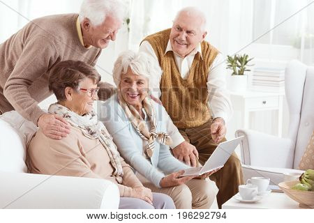 Group of elderly people enjoying modern technology in a retirement home