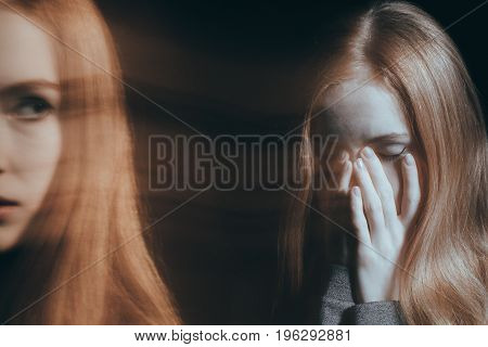 Girl covering her mouth in an emotional breakdown concept