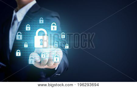 Businessman pointing virtul lock key Data protection business cyber security technology concept