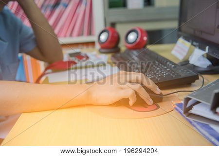 Woman hand on the mouse working in office. Business concept.
