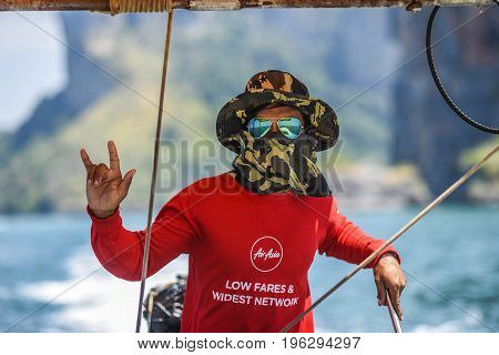 Krani Thailand March 09 2016: Portrait of a man sailing a long tail boat in Thailand.