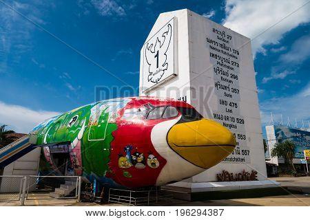 Ayutthaya Thailand - June 13 2017 : The Giant Milestone and the angry bird painted airplane at Tung bua chom floating market Wangnoi Ayutthaya Thailand.