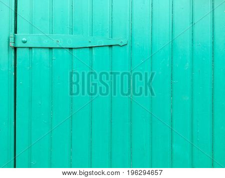 Wooden planks with old paint in bright color in closeup